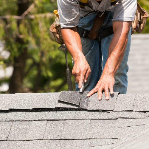 Fixing Shingles on a Residential Roof